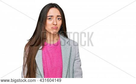 Young hispanic girl wearing business clothes depressed and worry for distress, crying angry and afraid. sad expression.