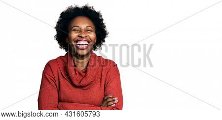 African american woman with afro hair with arms crossed gesture smiling and laughing hard out loud because funny crazy joke.