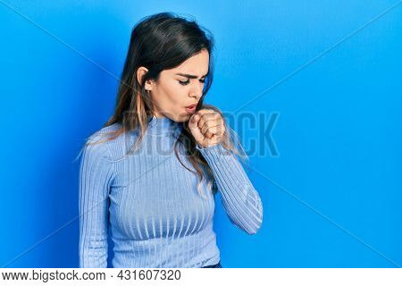Young hispanic girl wearing casual clothes feeling unwell and coughing as symptom for cold or bronchitis. health care concept.