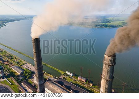 Aerial View Of Coal Power Plant High Pipes With Black Smokestack Polluting Atmosphere. Electricity P