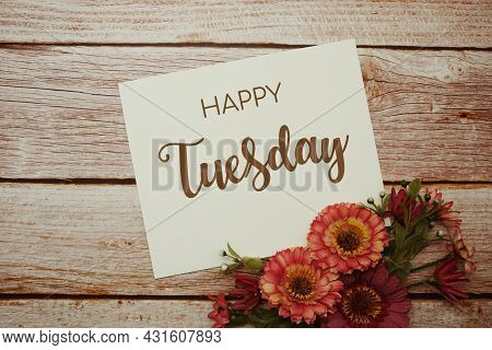 Happy Tuesday Card Typography Text With Flower Bouquet On Wooden Background