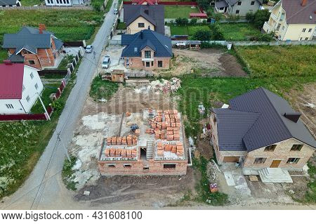 Aerial View Of Unfinished Frame Of Private House Under Construction In Suburban Area.