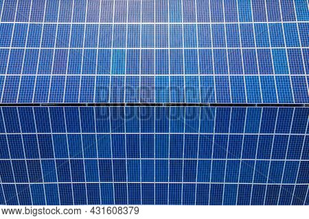 Aerial View Building Roof With Rows Of Solar Photovoltaic Panels For Producing Clean Ecological Elec