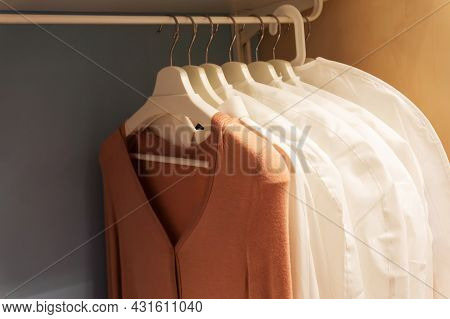 Old Clothes In A Closet On Hangers. Old-fashioned Things In The Wardrobe.