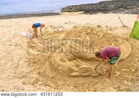 Fuerteventura, Canary Islands, Spain - September 17, 2018 : Making A Sand Sculpture On Corralejo Bea