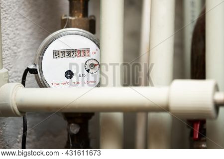 Water Meter Among The Plastic Water Pipes