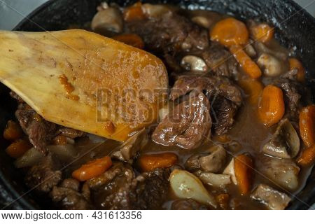 Ready Of Beef Burgeoning Beef Dish In A Frying Pan. Meat, Carrots And Onions And Mushrooms. Appetizi