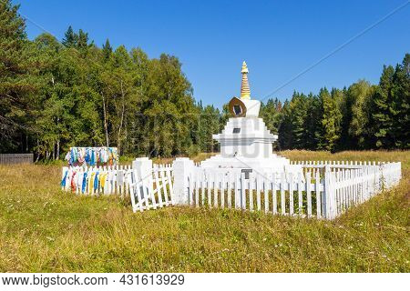 Ritual Buddhist Stupa Enlightenment On Summer Meadow Against Forest Near Krasnoyarsk, Russia. Transl