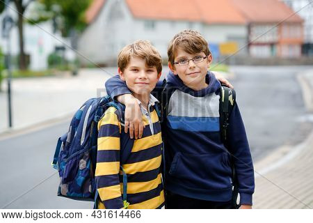 Two Kid Boys With Backpack Or Satchel. Schoolkids On The Way To School. Healthy Smiling Children, Br