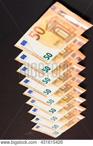 Diagonal Line Of Euro Notes Isolated On Black Background, Salary In Euros.