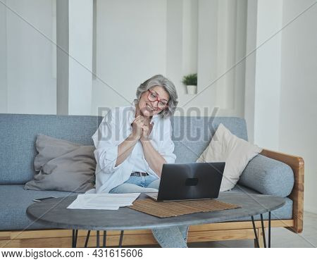 Happy Enthusiastic Overjoyed Senior Mature Old Woman Received A Joyful Letter On Laptop.