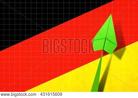 Upward Arrow On The Background Of The Flag Of Germany. Paper Plane. Economic Recovery. Copy Space. B