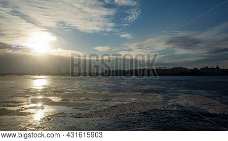 March 30, 2019. Ice Floes On The Melting Neva River In St. Petersburg Against The Setting Sun