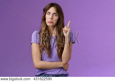 Strict Funny Curly-haired Girl Pulling Disappointed Angry Face Popping Eyes Stare Camera Shaking Ind