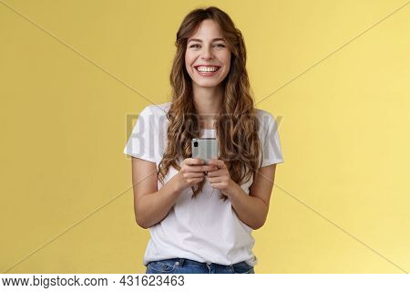 Cheerful Carefree Happy Lively Girl Hold Smartphone Using Awesome Funny App Playing Cool Game Relaxi