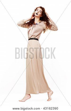 Muse. Serene Barefoot Frizzy Redhead Woman In Toga Walking. Curly Hairs