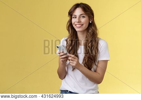 Feminine Lovely Curly-haired Woman White T-shirt Hold Smartphone Picked Awesome New Song Listen Musi