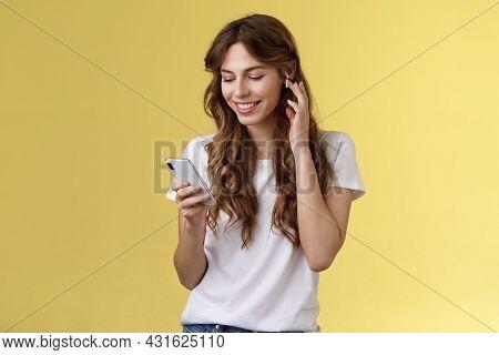 Tender Feminine Curly-haired Female White T-shirt Touch Wireless Earbud Put Earphone Ear Smiling Ple