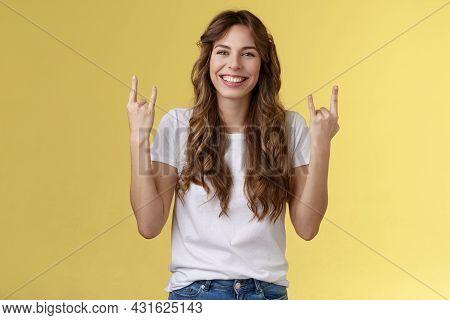 Happy Cheerful Feminine Caucasian Girl Curly Hairstyle Show Rock-n-roll Heavy Metal Gesture Smiling