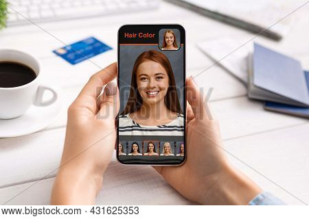 Woman Using Hair Color Simulation Software On Mobile Phone
