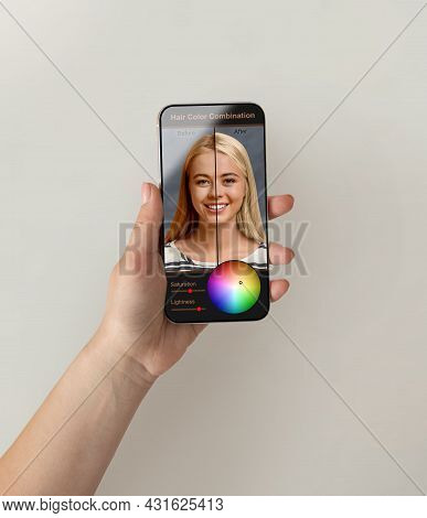Female Hands Using Hair Color Simulation Software On Mobile Phone