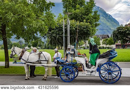 Switzerland, Interlaken, August 2021 - Horse Carriage Entertainment On Hoheweg Main Street \nin Cant