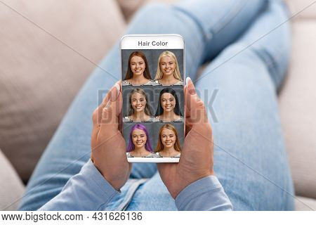 Beautiful Woman Checking Hair Color Simulation Mobile Application On Smartphone
