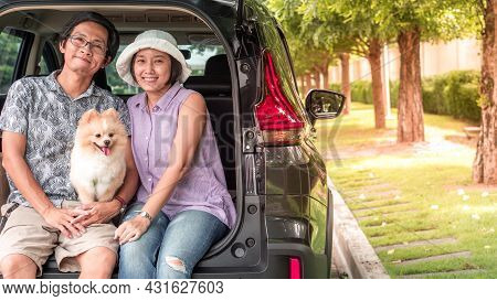 Dog With Owner Concept -  Asia Couple Family With Lovely Puppy Pomeranian Dog At The Back Of Suv Car