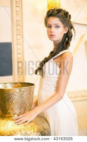 Luxurious Posh Brunette In White Dress. Oriental Antique Golden Decor