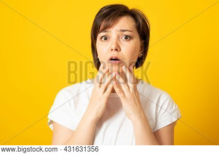 Surprise Astonished Woman. Portrait Woman Looking Surprised In Full Disbelief Wide Open Mouth Isolat