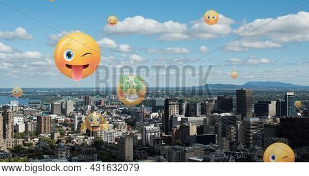 Image of emoji icons flying up over cityscape. global social media, networking and online technology concept digitally generated image.