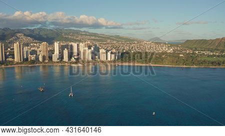 A Drone View At Sunset Of Waikiki Beach And Diamond Head Crater, A Famous Tourist Destination In Hon