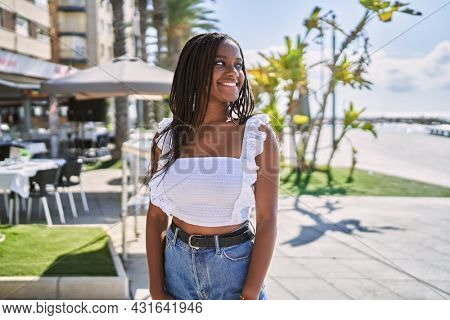 Young african american girl smiling happy standing at the promenade