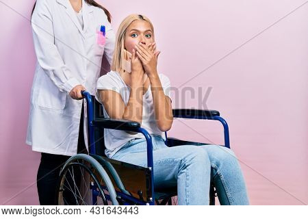 Beautiful blonde woman sitting on wheelchair with collar neck shocked covering mouth with hands for mistake. secret concept.