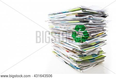 Stack of waste paper, old magazines, newspapers and leaflets for recycling isolated on white