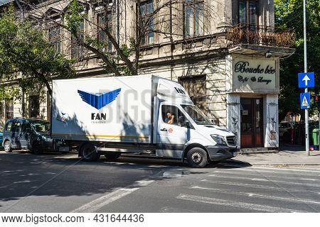 Fan Courier Delivery Van On The Streets Of Bucharest. Fan Courier Is The Largest Delivery Company In