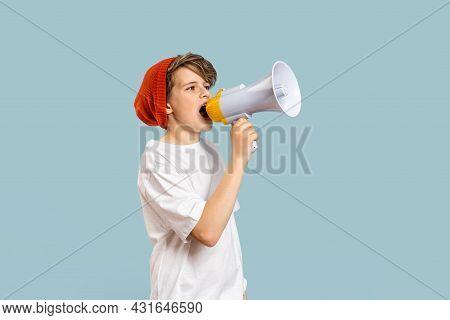 School Boy With Megaphone. Back To School Text