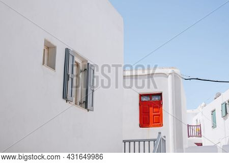 View Of Traditional Whitewashed Houses With Red And Blue Details In Hora (mykonos Town), Mykonos, Gr
