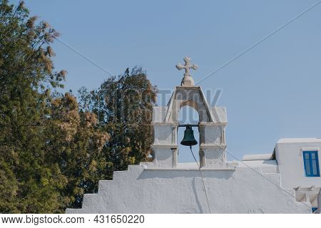 Low Angle View Of The Bell And Cross On A Church In Hora (mykonos Town), Mykonos, Greece.