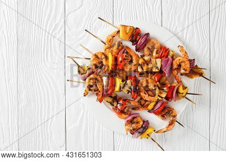Grilled Shrimp Kabobs With Charred Red Onion, Sweet Pepper And Pineapple On A White Plate, Flat Lay,