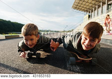 Two Boys In Skates. Brother's Love.