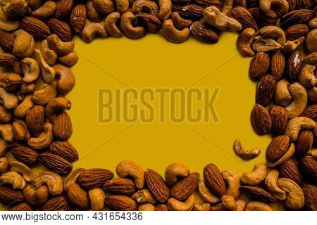 Place To Insert In The Middle, Surrounded By Cashews And Almonds. Frame In The Form Of Nuts. Yellow