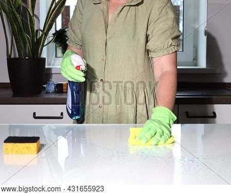 Housewife Is Using Antiseptic Spray For Wiping Table. Washing Surfaces With Towel And Gloves.