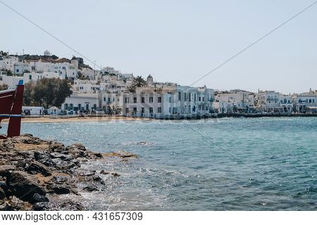 Mykonos Town, Greece - September 24, 2019: View Over The Aegean Sea Of The Coastal Buildings In Hora