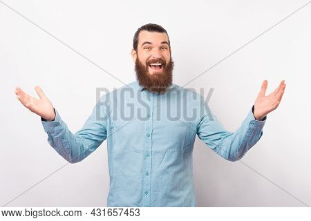 Let Me Give You A Hug. Bearded Man Is Standing With Arms Open Wide Ready For An Embrace.