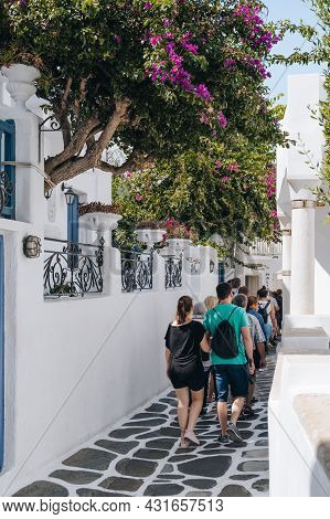 Mykonos Town, Greece - September 23, 2019: Rear View Of Tourists Walking On A Street In Hora (also K