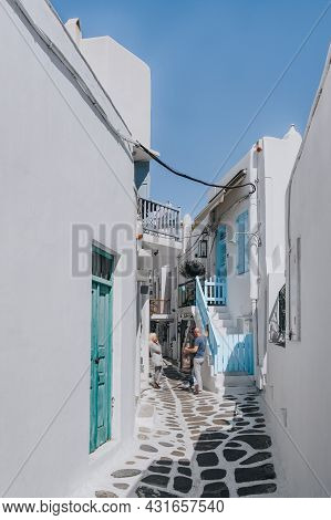 Mykonos Town, Greece - September 24, 2019: View Of Whitewashed Buildings On A Narrow Street In Hora