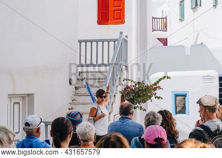 Mykonos Town, Greece - September 23, 2019: Tour Guide Talking To A Group Of Tourists On A Street In