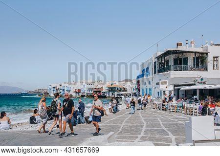 Mykonos Town, Greece - September 23, 2019: People Walking On A Street In Little Venice Past The Sea