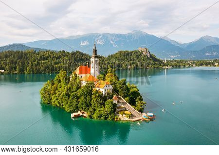Panoramic View Of Lake Bled With Assumption Of Maria Church On Island On The Background Of Julian Al